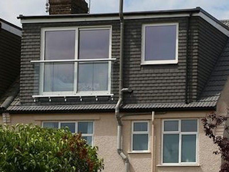 A Flat Roof Dormer Loft Conversion in Bristol with a juliet balcony