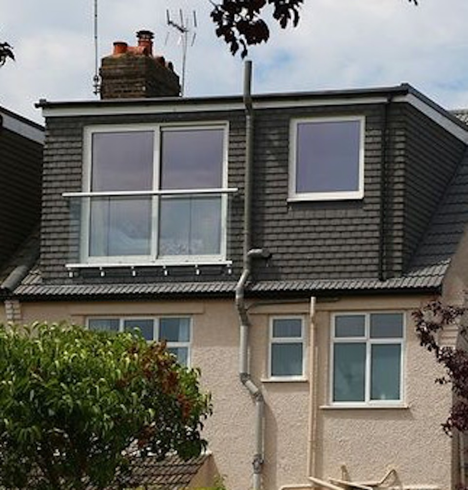 A Flat Roof Dormer Loft Conversion in Bristol with a juliet balcony