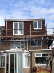 A brown Flat Roof Dormer Loft Conversion in Bristol
