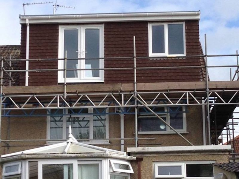 A brown Flat Roof Dormer Loft Conversion in Bristol
