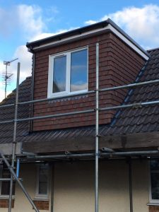 A small brown flat roof dormer loft conversion in Bristol
