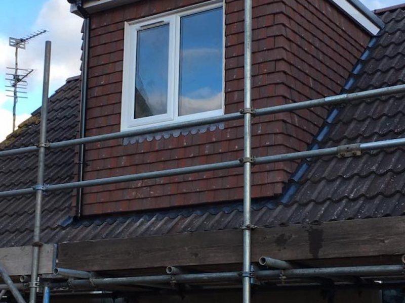 A small brown flat roof dormer loft conversion in Bristol