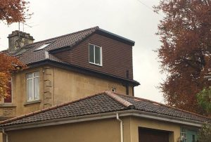 A brown wrap around dormer loft conversion in Bristol