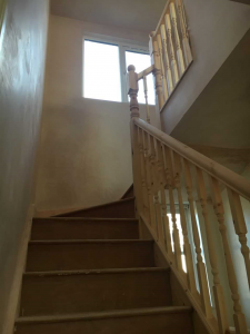 Wooden stairs in the process of being built during a loft conversion