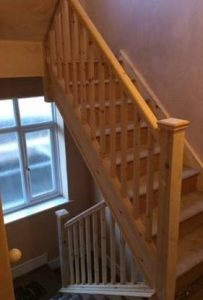 Unfinished wooden stairs leading to a loft conversion