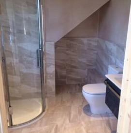 An attic space that has undergone a loft conversion and is now a modern bathroom