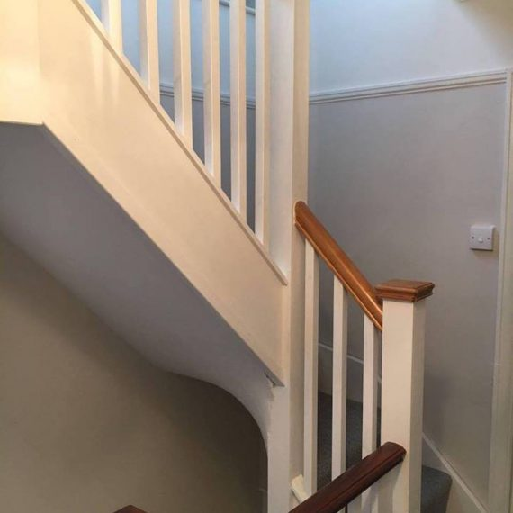 Stairs and banister leading to a loft conversion in Bristol