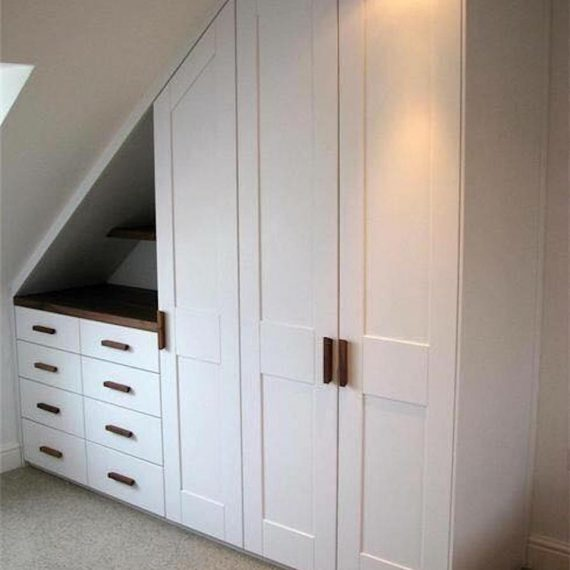A wardrobe built into a loft conversion