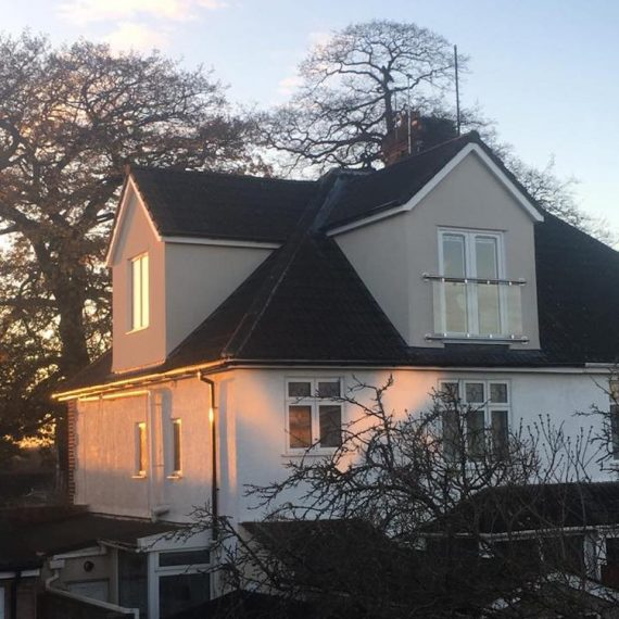 The sun setting on a new pitched roof dormer loft conversion in Bristol