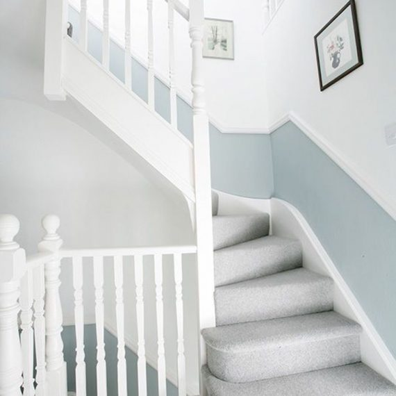 Grey carpeted stairs with white and blur wallpaper leading to a new loft conversion in Bristol