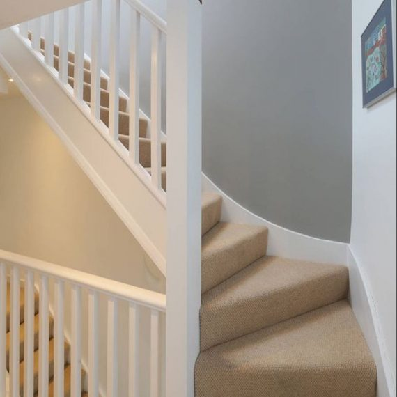 Stairs with Carpet leading up to a loft conversion