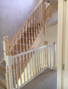 Wooden stairs to a loft conversion that is a work in progress